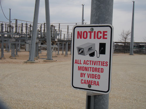 utility surveillance warning sign