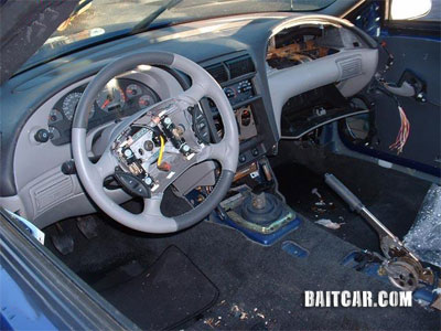 A Ford Mustang stripped of its airbags and other interior components.