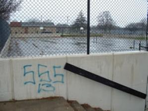 Graffiti tagging and other forms of defacement often mar school buildings and grounds.