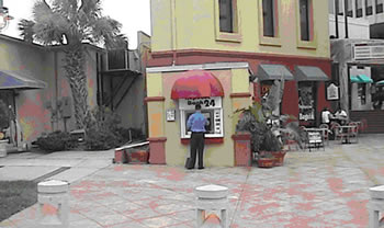 This ATM is placed well, using good CPTED features and has an unobstructed view from the street and patrolling police.